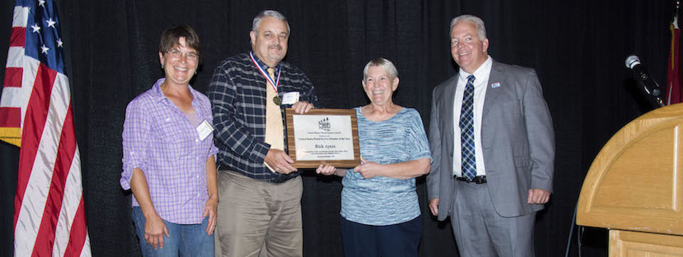 Rick Ayers receiving United States Postal Service Member of the Year